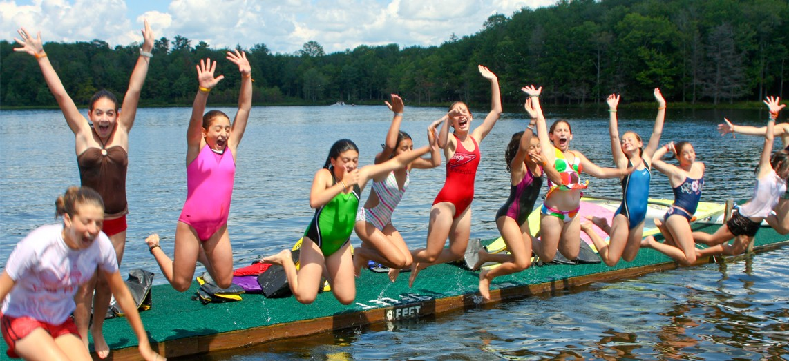 girls-jumping-dock